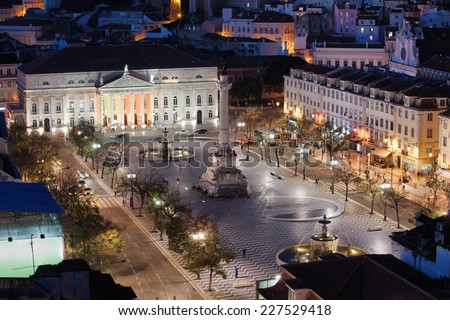 Rossio Square at night in the city centre of Lisbon, Portugal. - stock photo