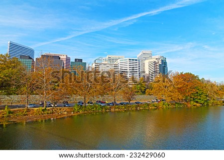 Rosslyn scenic skyline and Potomac river bank in autumn. Office buildings viewed from Theodore Roosevelt Bridge, Washington DC.  - stock photo