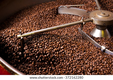 Rosting process of coffee - stock photo