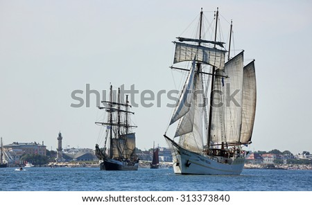 ROSTOCK, GERMANY - AUGUST 06, 2015 Old sailing ships Mare Frisum (NL) and Fridtjof Nansen (GER) sailing near Rostock on August 06, 2015 in the scope of the 25th Hanse-Sail Rostock, Germany - stock photo
