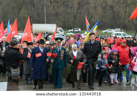 ROSTOV-ON-DON, RUSSIA - APRIL 11: The rally, placing flowers  International automobile race �«Our Great Victory�» in honor of the Day of Victory in the WWII, April 11, 2013 in Rostov-on-Don, Russia