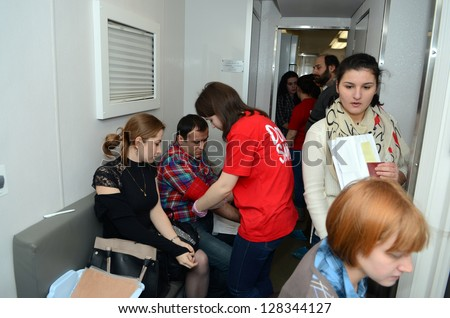 ROSTOV-ON-DON, RUSSIA - FEBRUARY 15: Donors in the queue - Donor action is devoted to the International Day children with cancer, February 15, 2013 in Rostov-on-Don, Russia.