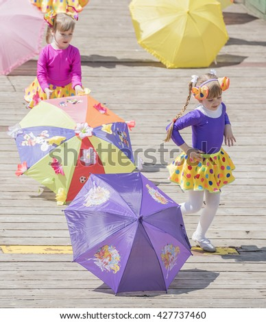 Rostov-on-Don, Russia- May 22,2016: Dance of the girls with colored umbrellas at the carnival