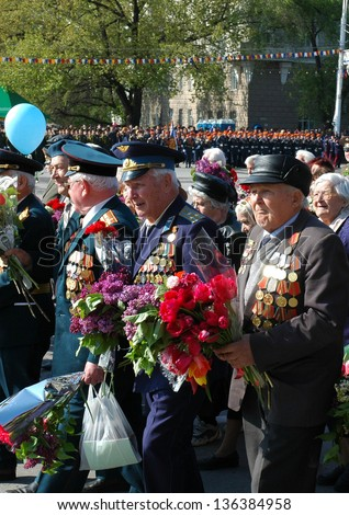 ROSTOV-ON-DON, RUSSIA - MAY 9: Veterans of the Great Patriotic War during the celebration of the 61th anniversary of Victory Day (WWII) at Theater Square, May 9, 2006 in Rostov-on-Don, Russia