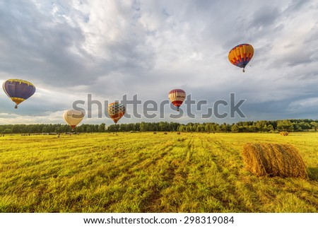 "Rostov, Russia - July 17, 2015: Evening flight of the hot air balloons during the ""Golden ring"" festival."