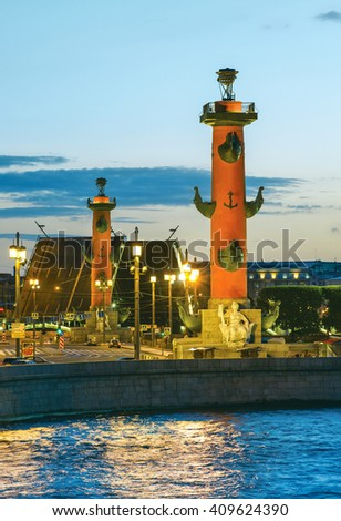 Rostral Columns and raised Birzhevoy (Exchange) Bridge in distance. White Nights in St.-Petersburg, Russia - stock photo