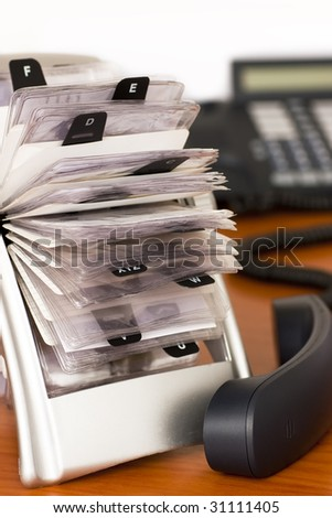 Rotary card file holder with Phone - stock photo