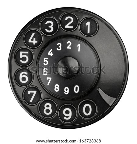 rotary dial pad of an old telephone - stock photo