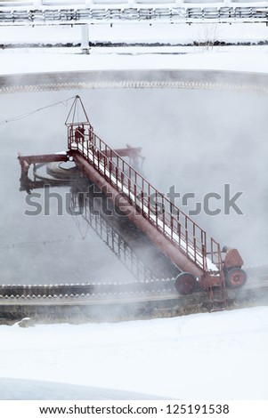 Rotation of filter in radial sedimentation basin with water evaporation - stock photo