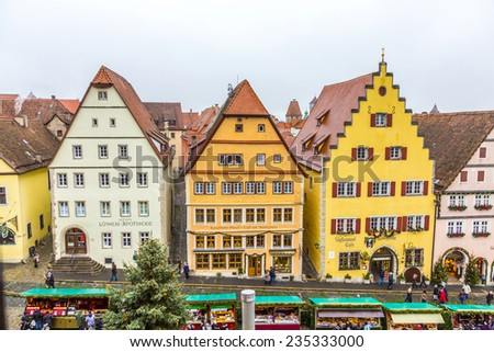 ROTHENBURG, GERMANY - DEC 2, 2014: Tourists at the market place of Rothenburg ob der Tauber, Germany. The medieval town attracts over 2 million visitors every year.