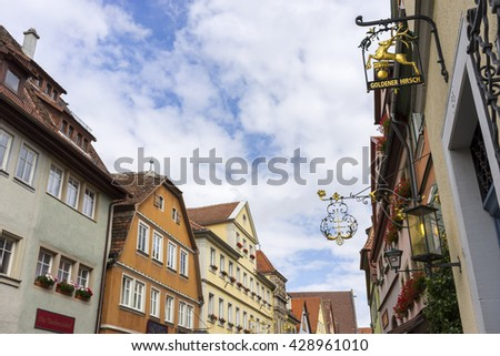 Rothenburg ob der Tauber, Germany - July 28, 2015: Street view of Rothenburg ob der Tauber, a well-preserved medieval old town in Middle Franconia on popular Romantic Road through southern Germany.