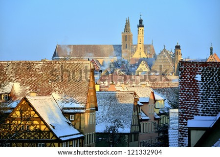 ROTHENBURG OB DER TAUBER IN SNOW, GERMANY - medieval town with famous christmas market - stock photo