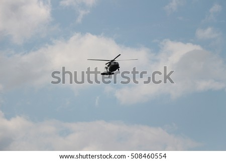 Rotorcraft, , flying up in the sky.