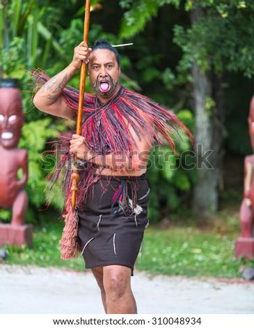 ROTORUA, NEW ZEALAND - 30 JANUARY 2015: Maori tribes traditional greeting show. Vicinity of Rotorua town. The Maori are the indigenous Polynesian people of New Zealand.  - stock photo