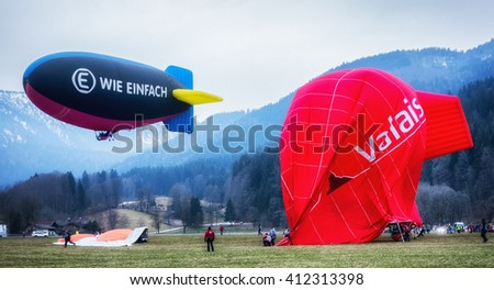 ROTTACH, GERMANY - FEB 28: blimp (hot air airship) landing at the european alps on feb 28, 2016 in rottach, germany - stock photo
