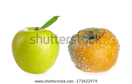 Rotten apple and fresh green apple isolated on white background. Clear Skin concept - stock photo