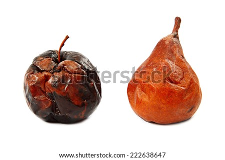 Rotten apple and pear isolated on white background.