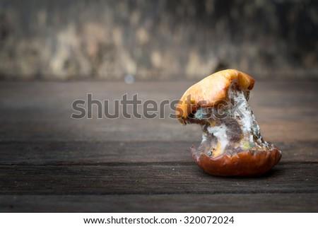 Rotten apples on old wooden , Still life Style - stock photo