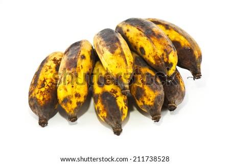 Rotten banana on white background - stock photo