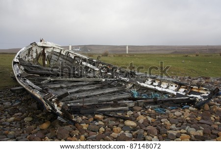 rotten boat in scottish coastal landscape