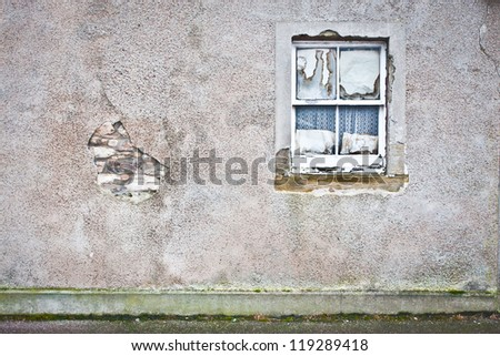 Rotten window pane in a derelict house - stock photo