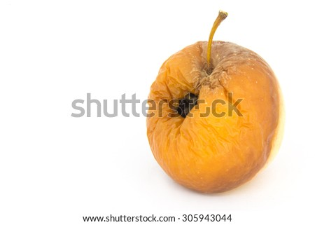 rotten yellow apple with bite mark on white background - stock photo