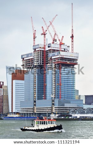 "ROTTERDAM-AUG. 7: Construction site on Aug. 7, 2012 in Rotterdam, The Netherlands.  Building ""The Rotterdam"" is designed by Rem Koolhaas, has three 150 m towers, cost 350 million euro and should be ready in 2013. - stock photo"