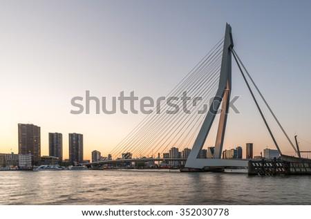 Rotterdam City, Erasmus Bridge ((Erasmusbrug)) Panorama Twilight View  across the Nieuwe Maas (New Meuse) River and Skyline Cityscape under Golden Sunset at Dusk in Evening, the Netherlands - stock photo