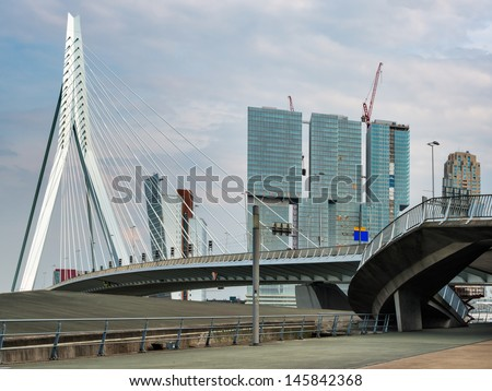 ROTTERDAM, HOLLAND may 28. Panoramic view over Erasmus Bridge and new architecture in Rotterdam on may 28, 2013. Erasmus Bridge is one of the icons of Rotterdam  in  Holland. - stock photo