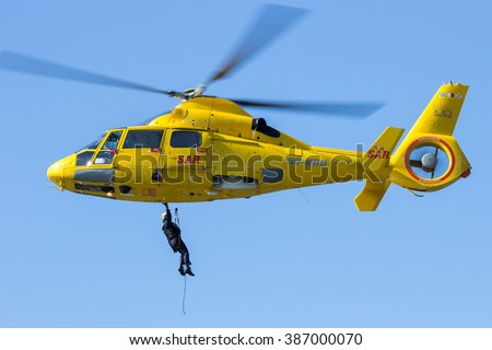 ROTTERDAM, HOLLAND - SEP 7, 2012: Demonstration of a rescue operation by helicopter during the World Harbor Days. - stock photo