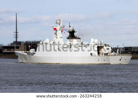 ROTTERDAM - JAN 30, 2015: Chinese PLA Navy multi-role frigate Yuncheng (571) is leaving the Port of Rotterdam after the first visit ever of the Chinese PLA Navy to The Netherlands. - stock photo
