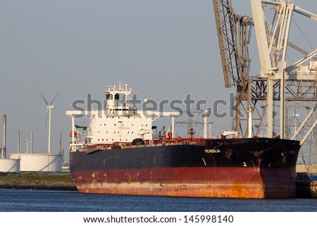 ROTTERDAM - JULY 9: A tanker docking on July 9, 2013 in Rotterdam, the Netherlands. Rotterdam is the main European harbour and used to be the world's largest container port from 1962 until 2002 - stock photo