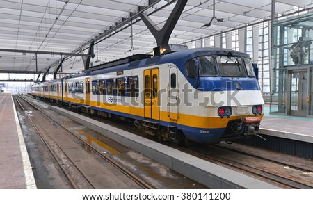 ROTTERDAM - JULY 19: Dutch Nederlandse Spoorwegen train departing from Rotterdam Station on July 19, 2015 in Rotterdam, The Netherlands. Nederlandse Spoorwegen company operates 4,800 trains a day. - stock photo