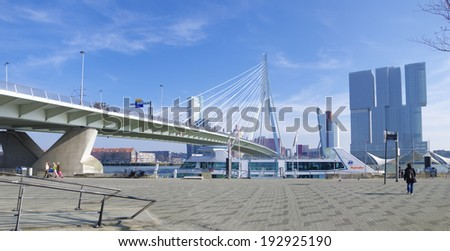ROTTERDAM - MARCH 8, 2014: View on the famous Erasmus bridge in Rotterdam. The bridge measures 802 meter and was completed in 1996. - stock photo