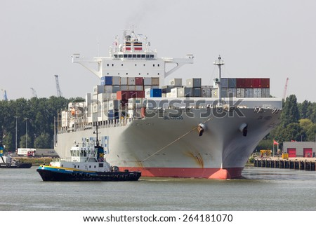ROTTERDAM, NETHERLANDS - AUG 1, 2014: Container ship Dal Karoo leaving the Port of Rotterdam. The port area is 105 square km and the largest port in Europe.  - stock photo