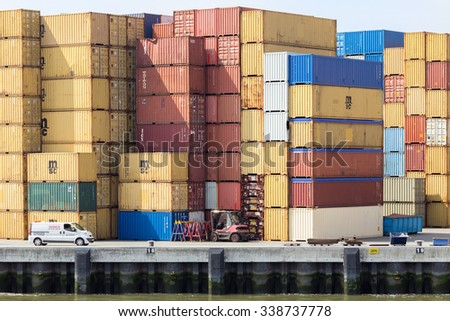 ROTTERDAM, NETHERLANDS - AUG 1, 2014: Sea container terminal in the Port of Rotterdam. The port is the largest in Europe and facilitate the needs of a hinterland with 40,000,000 consumers.  - stock photo
