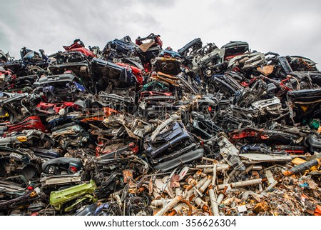 ROTTERDAM, NETHERLANDS - AUGUST 27, 2015: Piled up compressed cars as industrial background. Rotterdam - Netherlands.