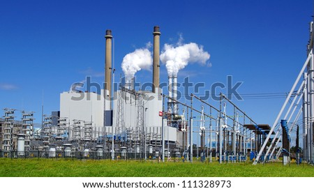 ROTTERDAM, NETHERLANDS - AUGUST 02: Refinery plant of a petrochemical industry at Europort harbor, Rotterdam on August 02, 2012 in Rotterdam Netherlands