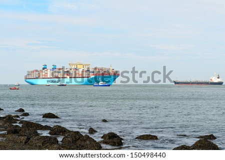 ROTTERDAM,NETHERLANDS-AUGUST 16: The world biggest container ship , the Maersk Mc-Kinney Moller , sailing for the first time into the harbor of Rotterdam Netherlands on august 16, 2013