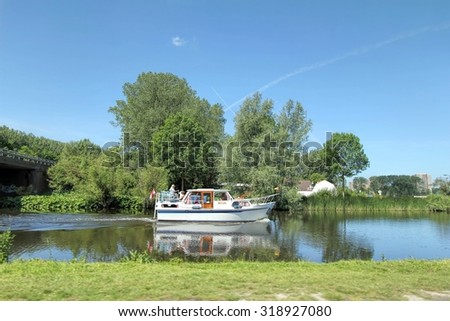 ROTTERDAM, NETHERLANDS,  JUNE 11, 2011 : Landscape of Dutch river in rural area of Rotterdam on June 11, 2011