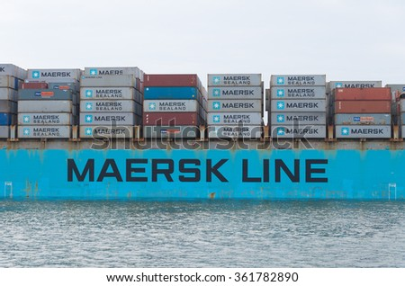 ROTTERDAM, NETHERLANDS - JUNE 28, 2015: Maersk Line container ship leaving the harbor. It is the world's largest container shipping company having customers through 374 offices in 116 countries. - stock photo