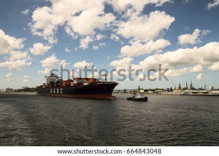 ROTTERDAM, NETHERLANDS - June 4th 2017:  Container ship entering the cargo port of Rotterdam, Netherlands. Editorial use only.