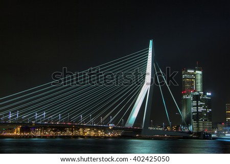 Rotterdam, Netherlands - March 5  The Erasmus Bridge at night reflecting in the river Nieuwe Maas - the confluence of the Rhine and Maas - on March 5, 2013.  - stock photo
