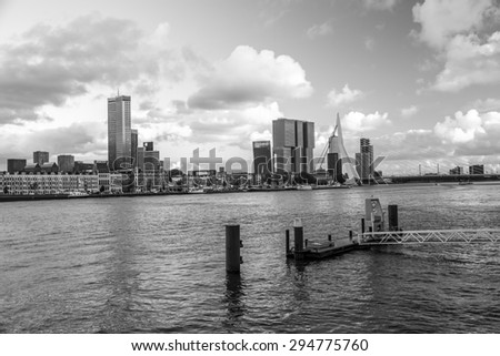 Rotterdam, Netherlands - May 26, 2015: View of the Erasmus Bridge in Rotterdam, a city defined by modern architecture. - stock photo