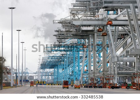 ROTTERDAM, NETHERLANDS - SEP 6, 2015: ECT and APM Container terminal in the Port of Rotterdam. The port is the largest in Europe and facilitate the needs of a hinterland with 40,000,000 consumers.  - stock photo