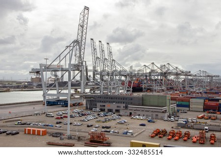 ROTTERDAM, NETHERLANDS - SEP 6, 2015: ECT Container terminal in the Port of Rotterdam. The port is the largest in Europe and facilitate the needs of a hinterland with 40,000,000 consumers - stock photo