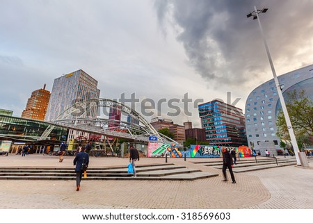 ROTTERDAM, NETHERLANDS - SEPTEMBER 03, 2015: cityscape with modern market hall in Rotterdam at dawn. It was opened Oct 1 2014 by Queen Maxima designed by architect firm MVRDV. With unidentified people