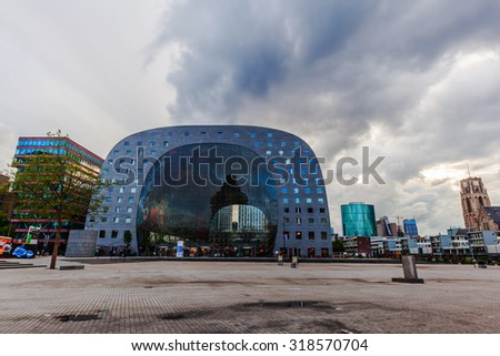 ROTTERDAM, NETHERLANDS - SEPTEMBER 03, 2015: market hall with unidentified people at dawn. It was opened on Oct 1, 2014, by Queen Maxima and designed by architect firm MVRDV