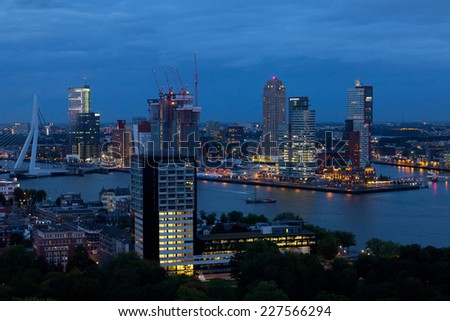 ROTTERDAM, NETHERLANDS - SEPTEMBER 28, 2012. View from air to night Rotterdam. The port of Rotterdam is the biggest in Europe. Port goods turnover in 2010 made 430 million tons - stock photo
