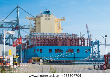 ROTTERDAM - OCTOBER 4, 2014: Container ship in Rotterdam port. It is the largest port in Europe, covering 105 square kilometers (41 sq miles) - stock photo